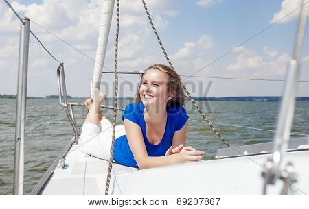 Travelling Concepts: Happy And Smiling Positive Caucasian Woman Relaxing On White Yacht On Board.
