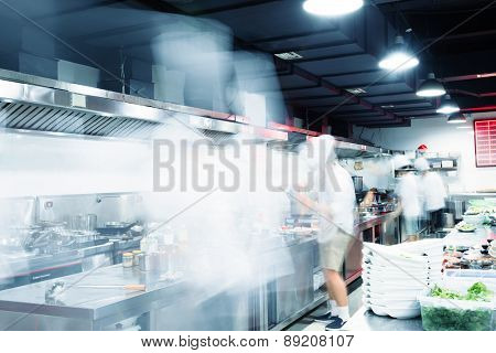 Modern kitchen and busy chefs in hotel