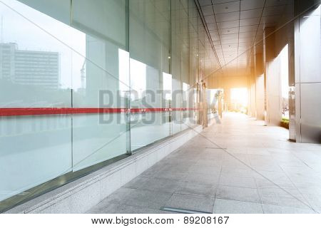 empty pavement of modern building exterior