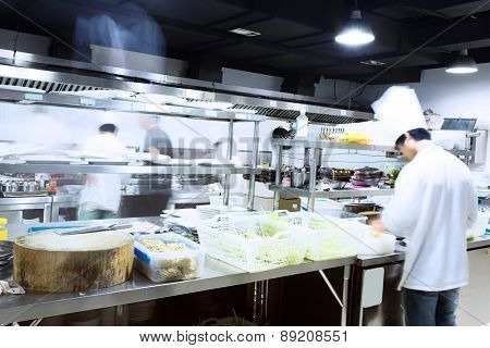 modern kitchen and busy chefs of hotel