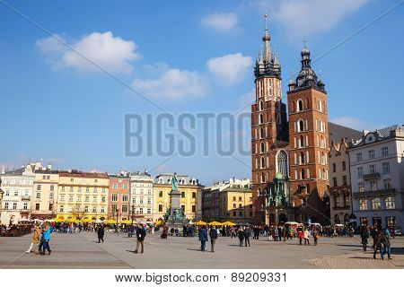 Krakow, Poland - March 07 2015: Unidentified Tourists Visiting Main Market Square