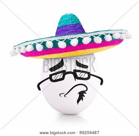 Concept white egg with face in a sombrero