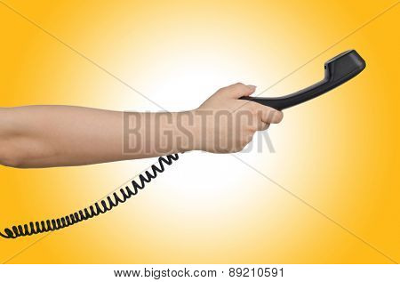 Hand with phone isolated on white
