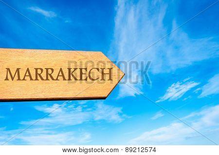 Wooden arrow sign pointing destination MARRAKECH