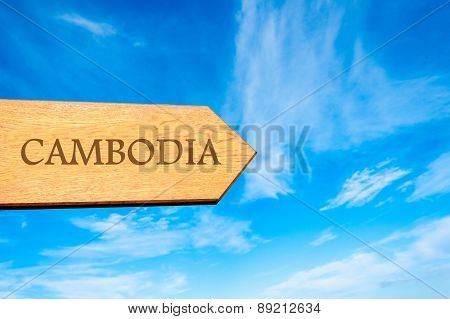 Wooden arrow sign pointing destination CAMBODIA