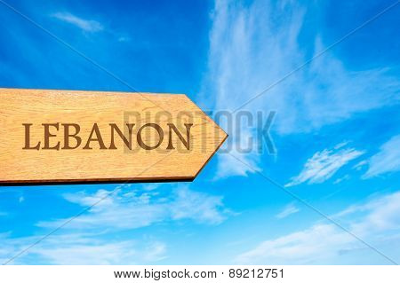 Wooden arrow sign pointing destination LEBANON