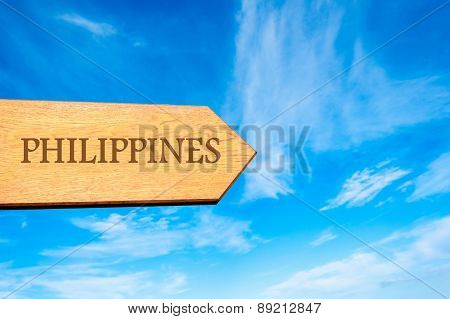 Wooden arrow sign pointing destination PHILIPPINES