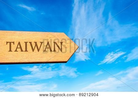 Wooden arrow sign pointing destination TAIWAN