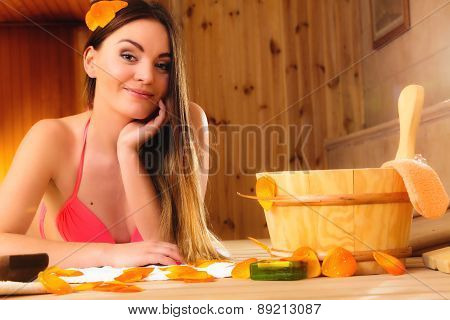 Young Woman In Wood Sauna.