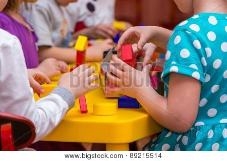 Children Hands Building Towers Out Of Wooden Bricks