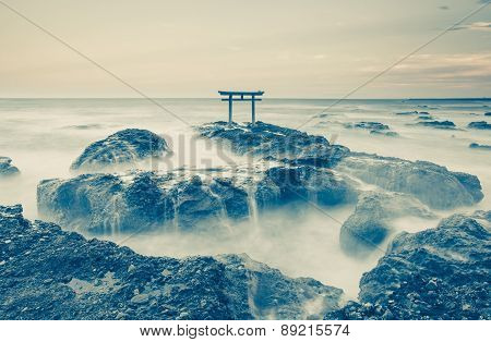 traditional Japanese gate and sea