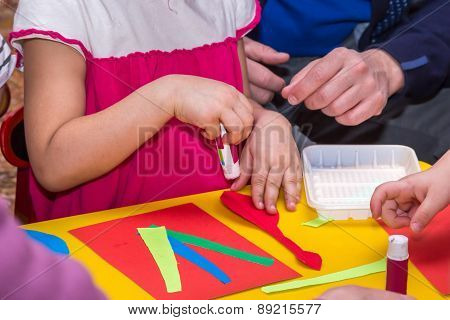 Children And Adults Hands Glue Colored Paper On Application Master Class