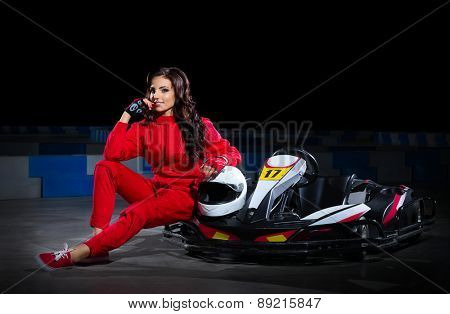Girl racer with kart isolated