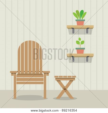 Garden Chair And Table With Pot Plants On Wooden Wall.