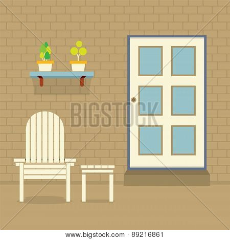 Garden Chair And Table With Pot Plants On Brick Wall.