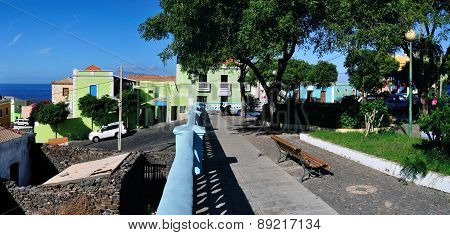 Colorful Buildings, Plaza And Bench