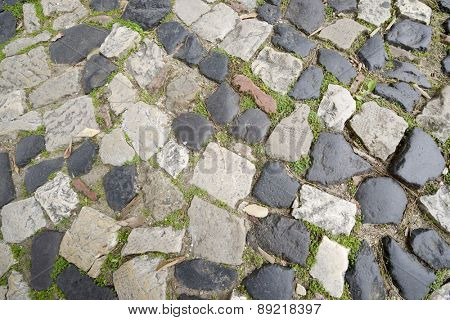 Floor of a street with stone tiles, Lisbon, Portugal.