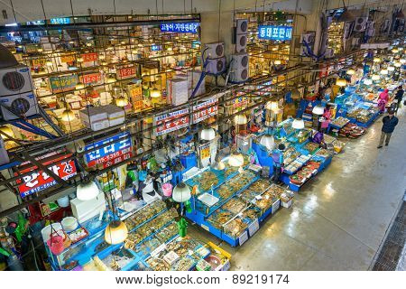 SEOUL - FEBRUARY 18, 2013: Aerial view of shoppers at Noryangjin Fisheries Wholesale Market The 24 hour market has over 700 stalls selling fresh and dried seafood.