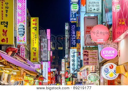 SEOUL - FEBRUARY 14, 2013: The neon lights of Myeong-Dong. The location is the premiere district for shopping in the city.