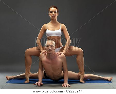 Yoga. Flexible athletes posing at camera