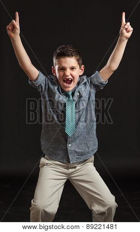 Young Boy Celebrating Pointing Number One