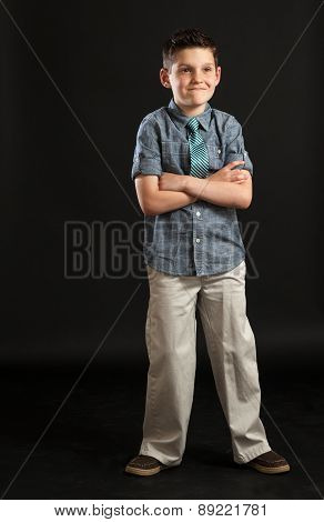 Young Boy With Arms Crossed