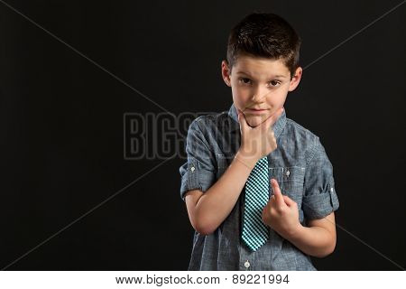 Young Confident Boy With Hand On Chin