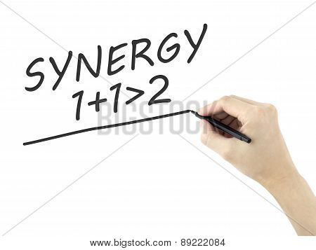 Synergy Word Written By Man's Hand