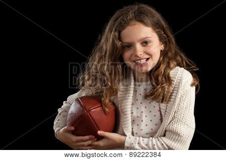 Young Girl Holding Football