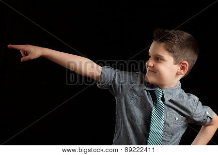 Young Boy Pointing In Direction