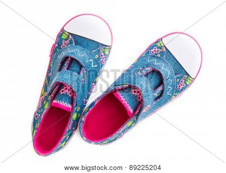 Children's denim shoes isolated on white background