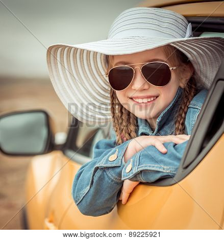 little girl traveling by car in the mountains close-up