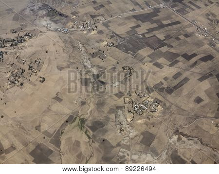 Aerial view of dry farmland and villages in Ethiopia