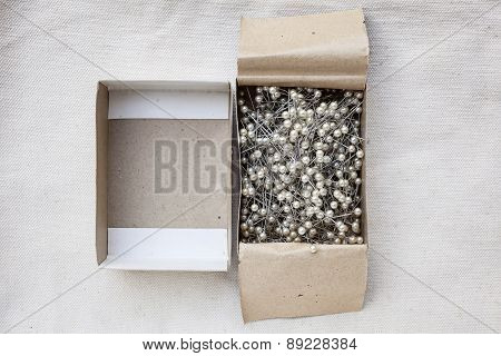 Pins In Paper Box Top view