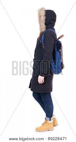 Back view woman in winter jacket with a backpack  looking up.   Standing young girl in parka. Rear view people collection.  backside view of person.  Isolated over white background.