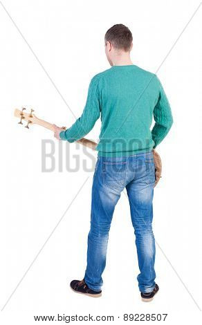 Back view of a young man with a guitar. Rock star with a musical instrument.  Rear view people collection.  backside view of person.  Isolated over white background.