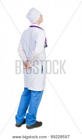 Back view of doctor in robe. Standing young guy. Rear view people collection.  backside view of person.  Isolated over white background. arms crossed behind nurse looking ahead.
