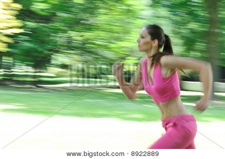 Young Woman Running Outdoor - Motion Blurr
