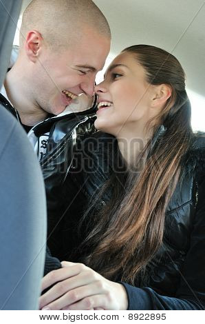 Young Couple Having Fun In Car