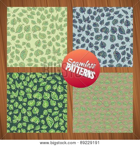 Seamless leaf pattern set. Seamless summer tiny floral patterns on wood background.