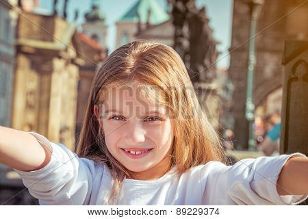 Beautiful little girl taken pictures of her self. Czech Republic, Prague