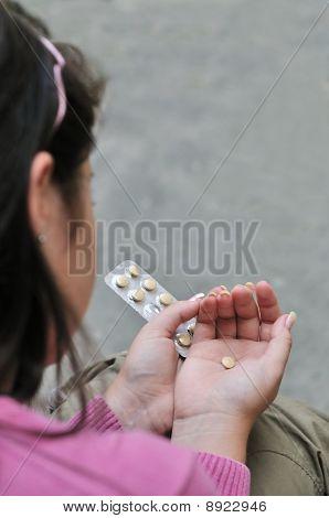 Teenager entscheidet über Pillen