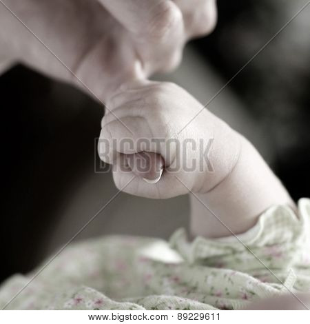 New born baby girl held by her mother