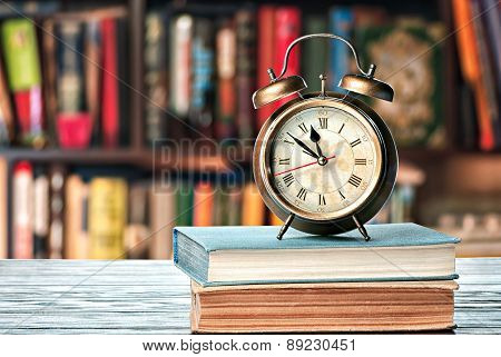 Book And Alarm Clock