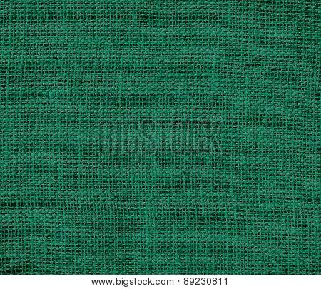 Bottle green color burlap texture background