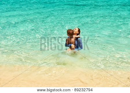 Mother and her little son at the tropical beach