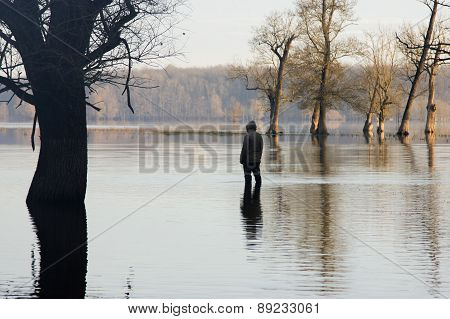 Man in jacket standing in the water