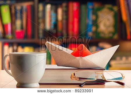 paper boat on the table