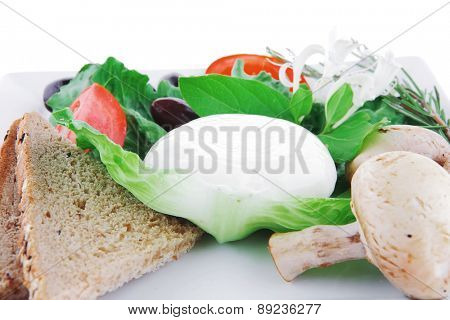 dairy food : mozzarella cheese and tomatoes over white plate isolated