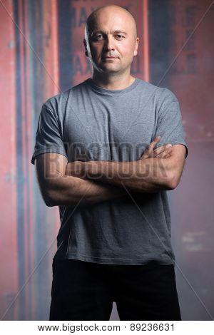 Portrait of a charismatic bald athlete.